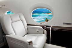 Aircraft (jet) porthole with view of sea and beach resort Stock Photo