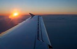 Aircraft jet wing with sunset Stock Photos