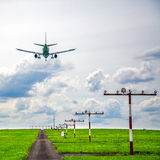 Aircraft landing at airport Stock Images