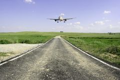 Aircraft landing in a beautifull landscape Royalty Free Stock Photos