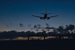 Aircraft upon landing at evening Stock Image