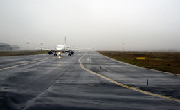 Aircraft landing on foggy runway Royalty Free Stock Photos