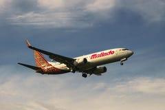 Aircraft landing. Kuala Lumpur, Malaysia, 27th January 2017, Malindo Air aircraft Boeing 737-800 landing at the airport Royalty Free Stock Photography