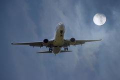 Aircraft Landing in Moonlight. An Aircraft landing with full moon Royalty Free Stock Images