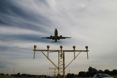 Aircraft is landing at the Rotterdam The Hague Airport over the landing lights. In Netherlands Stock Photo