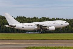 Aircraft is landing on the runway at airport Royalty Free Stock Photos