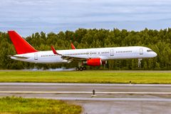 Aircraft is landing on the runway at airport Royalty Free Stock Photography