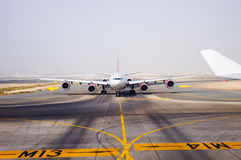 Aircraft on landing strip stock images