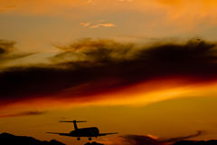 Aircraft Landing At Sunset Stock Images