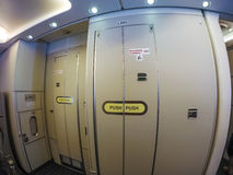 Aircraft lavatory. Door stock photography