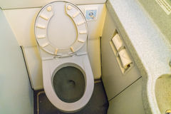 Aircraft lavatory toilets aboard a jetliner airplane . Stock Photos