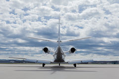 Aircraft learjet Plane in front of the Airport with cloudy sky. And Jet engine stock images