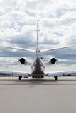 Aircraft learjet Plane in front of the Airport with cloudy sky. And sun Royalty Free Stock Photography