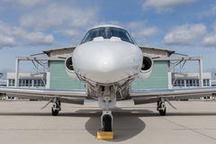 Aircraft learjet Plane in front of the Airport with cloudy sky. And sun Stock Photography