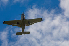 Aircraft. Light weight one propeller aircraft from beneath Royalty Free Stock Image