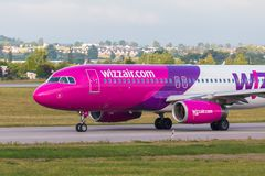 Aircraft line Wizzair taxiing on the airport runway. stock photos