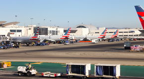 Aircraft lined up being prepared for flight at Los Angeles International LAX Airport Stock Photos