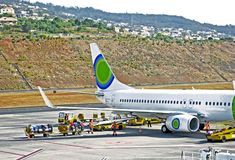 Aircraft loading at the airport. Loading of passangers` luggage into airplane on the airport of Madeira Island, Portugal Stock Images