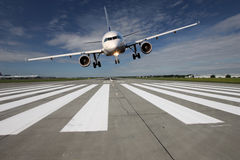 Aircraft low over the runway Royalty Free Stock Photos