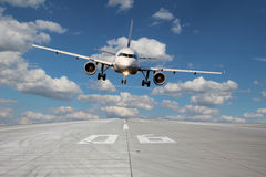Aircraft low pass. Aircraft passes low over runway 06 with beautiful clouds in the background stock images