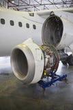Aircraft maintenance. Dismantled plane engine under maintenance Royalty Free Stock Image