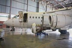 Aircraft maintenance. Dismantled plane engine under maintenance in the hangar Stock Photo