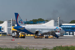 Aircraft maintenance before departure. Airplane A319 of the Ural Airlines, Rostov-on-Don, Russia, August 25, 2014 Royalty Free Stock Photos