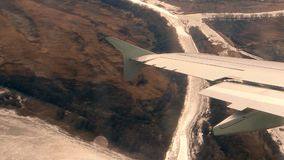 Aircraft make turn over the river. Wing of aircraft look through dusty window vintage color look. Aircraft make turn over the river. Wing of aircraft look stock footage