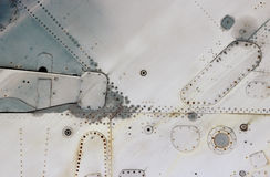 Aircraft metal surface with aluminum and rivets Royalty Free Stock Photo