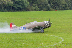 Aircraft - Model Aircraft - low wing aerobatics. Aerobatic aircraft with smoke on a model air show Stock Photography