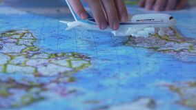 Aircraft model flying over world map, passenger transportation services, airline. Stock footage stock footage