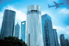 Aircraft and modern city Stock Photography