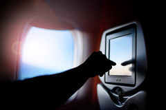 Aircraft monitor the passenger seat. Interior plane. Touch screen. Stock Photo
