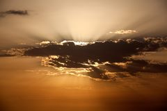 Aircraft from morning clouds over sea. Aircraft moving from morning orange clouds over sea royalty free stock photo