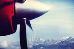 Aircraft in Nepal. View of Himalaya mountains through an aircraft window stock photography