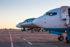 Aircraft noses in the airport apron. Aircraft noses in the morning the airport apron Stock Image