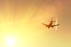 Aircraft, one high, another low sky at sunset sun.  Stock Photo