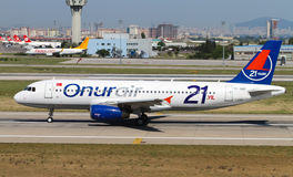 Aircraft. Onur Air Airbus A320-232 accelerate to takeoff at Ataturk Airport on May 26, 2013 in Istanbul, Turkey. Onur Air has 34 aircraft with 16 scheduled royalty free stock image