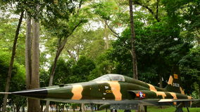 Aircraft outside Presidential Palace. Pan Down Russian MIG Aircraft - Independence Palace - Ho Chi Minh City Vietnam stock video footage