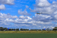 Aircraft over fields and road Royalty Free Stock Images