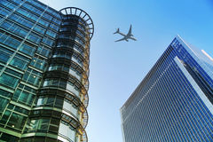 Aircraft over the London's skyscrapers going to land in the City airport Stock Image