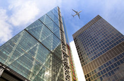 Aircraft over the London's skyscrapers going to land in the City airport Stock Photography