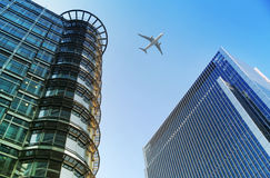 Aircraft over the London's skyscrapers going to land in the City airport Royalty Free Stock Images
