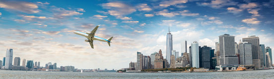 Aircraft overflying New York City skyline Stock Photos