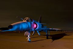 Aircraft painted. Cheetah fighter plane painted with light at night stock photography