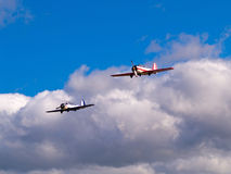 Aircraft pair. Pilotage of aircraft pair on blue sky with clouds Stock Photo