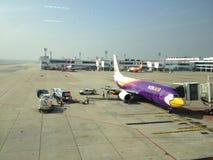 Aircraft at parking area. Aircraft park at gate ,Donmuang Thailand Royalty Free Stock Image