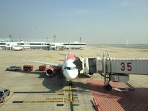 Aircraft at parking area. Aircraft park at Gate number 35 ,Donmuang Thailand Royalty Free Stock Photos