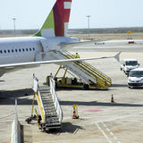 Aircraft passenger steps. Mobile airline passenger steps on airport apron Royalty Free Stock Photo