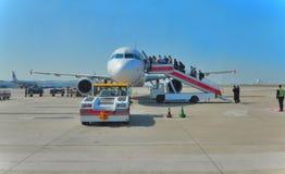 Aircraft and passengers Royalty Free Stock Photos
